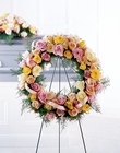 Vibrant Sympathy Wreath from Olney's Flowers of Rome in Rome, NY
